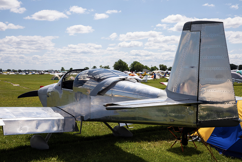 Airplane parked in a field with other aircraft at EAA AirVenture Oshkosh 2019