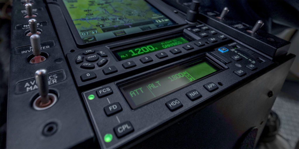 Stack in helicopter featuring mode controller, transponder and navigator