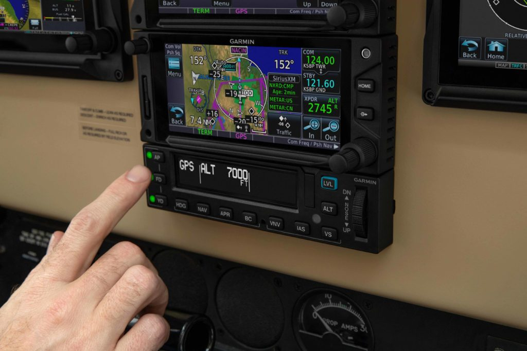 Pilot hand touching GFC 600 autopilot controller
