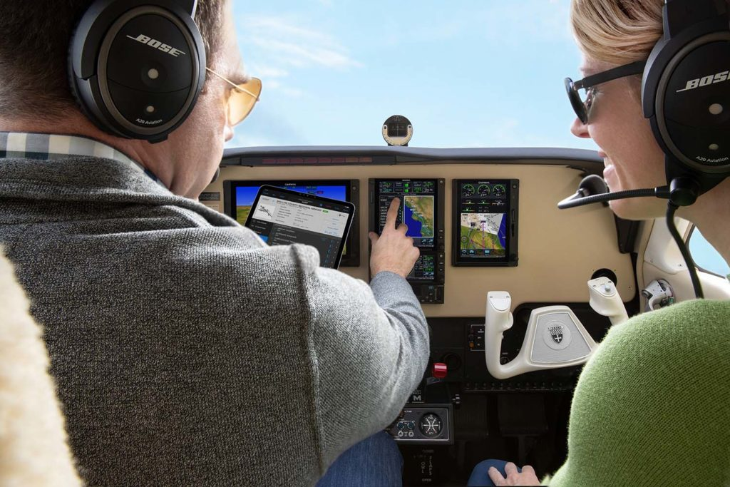 Pilot and passenger in cockpit interacting with GTN 750 Xi