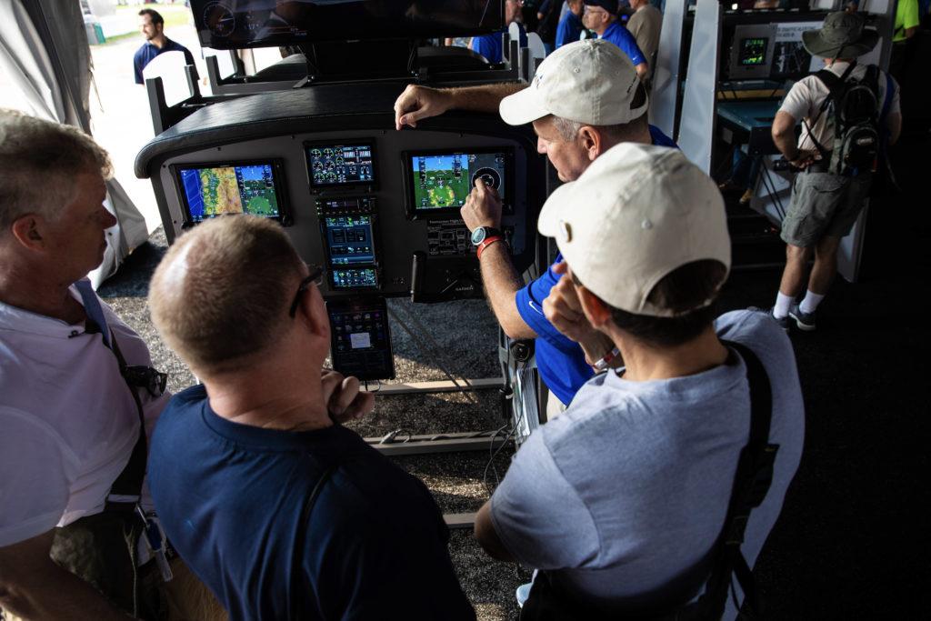 Customers getting a demonstration of Garmin avionics