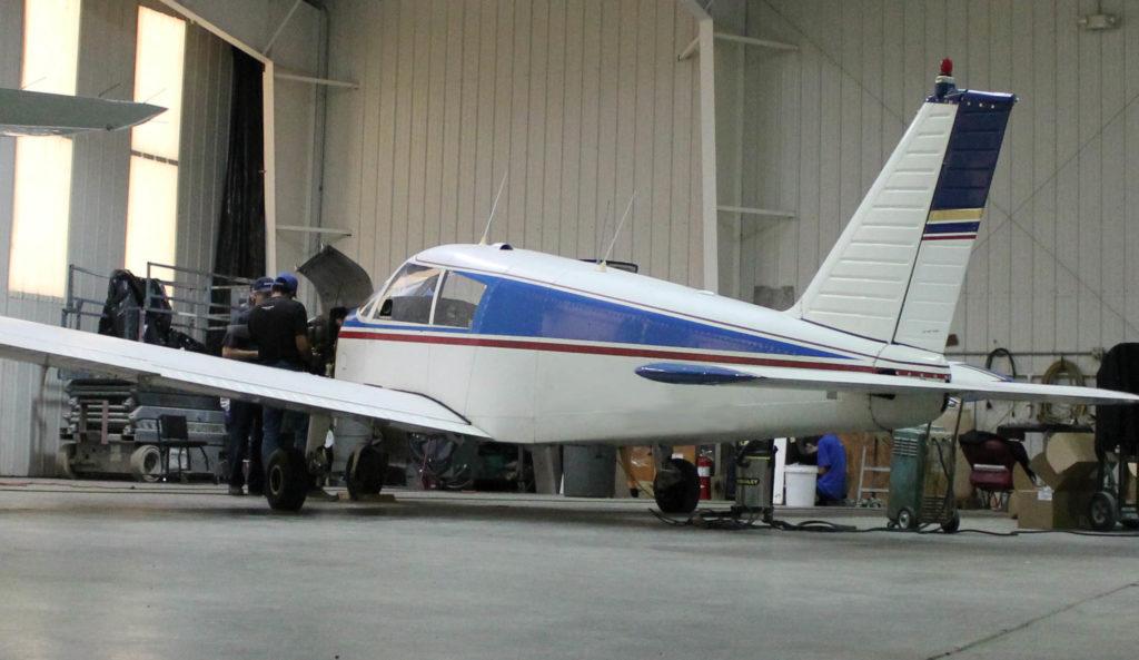 Piper Cherokee aircraft in hangar