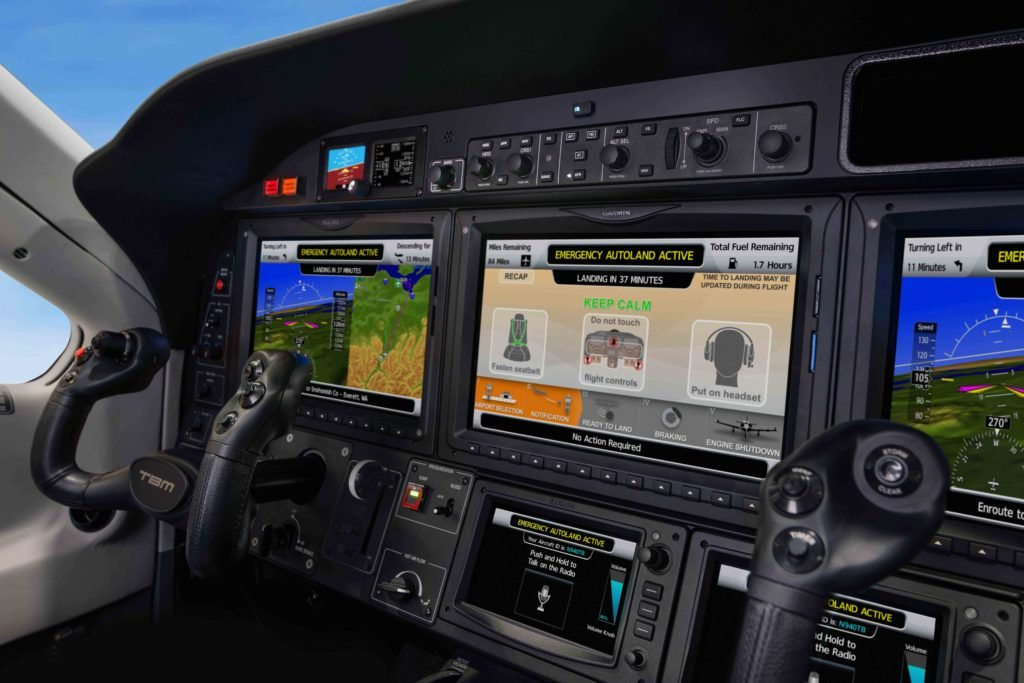Daher TBM 940 cockpit with screens showcasing Garmin Autoland activation.
