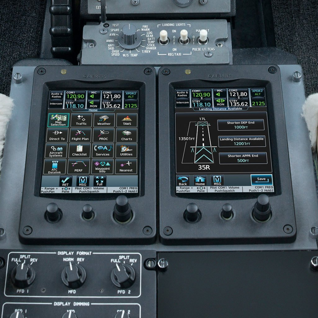 Touchscreen controllers on Garmin G5000 flight deck featuring Takeoff and Landing Data